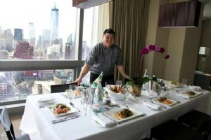 Executive Chef Desmond Lim presents sample of new in-room dining menu at Trump SoHo in New York City.