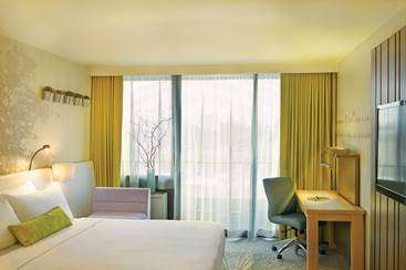 A guestroom at the soon-to-open Epiphany Hotel features contemporary décor.