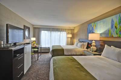Guestrooms at the renovated  Radisson Resort Orlando-Celebration feature contemporary décor.