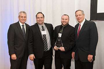 Recognizing the Team of the Year (l. to r.): Len Wolman