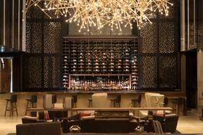The bar at the Hilton Santa Fe offers a spacious feel.