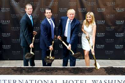 The Trumps dig in at the groundbreaking of the Trump International Hotel