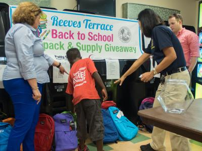 Carroll Adams' backpack giveaway project