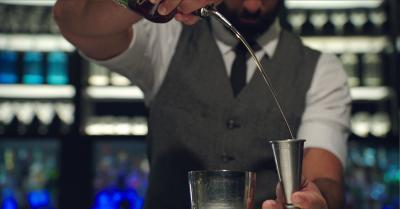 Marriott bartender making a bourbon drink