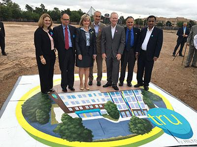 Hilton executives and local politicians at the groundbreaking ceremony