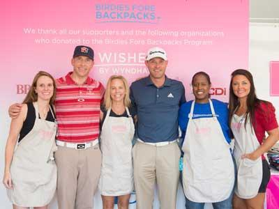 Wyndham Championship golfers and volunteers from