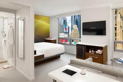 A guestroom at Luma Hotel Times Square features views of Manhattan.