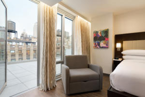 A king bed studio at the Embassy Suites by Hilton New York Midtown Manhattan.