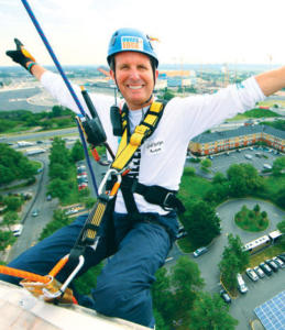 Wyndham Hotel Group President/CEO Geoff Ballotti rappelled down a building to raise awareness for Shatterproof.