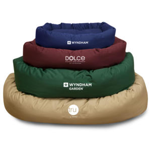 Amenity Services can customize dog beds with hotel logos.