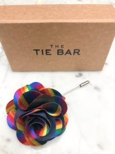 The Kimpton Gray Chicago has collaborated with Tie Bar for a Pride Month lapel pin.