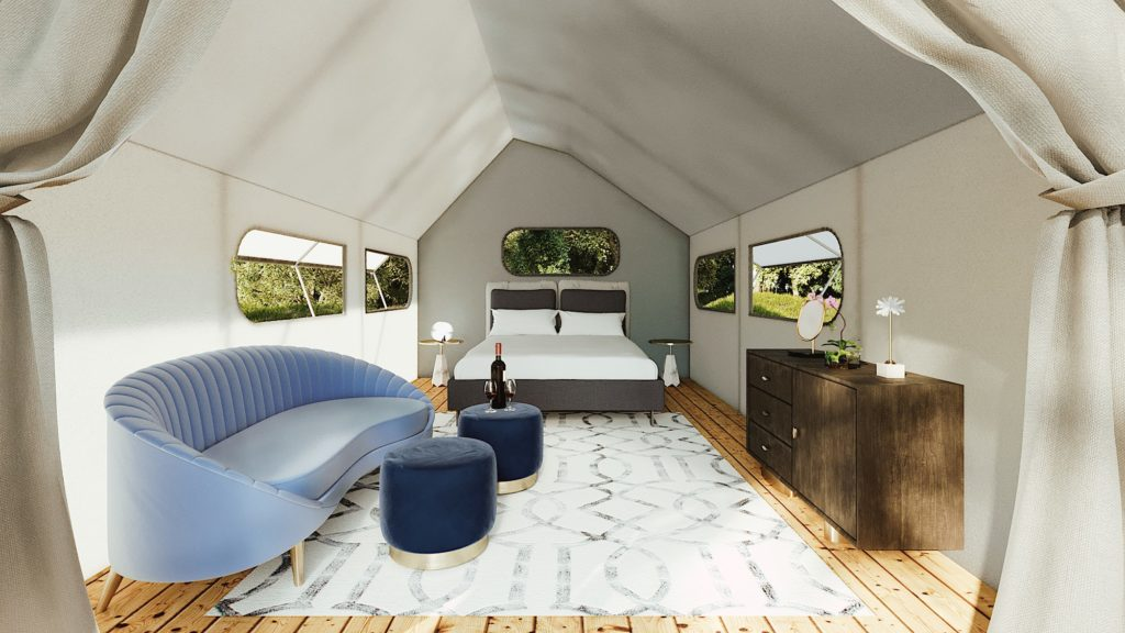 An interior view of a furnished Glampique tent.
